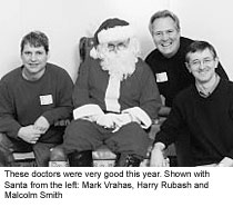 These doctors were very good this year. Shown with Santa from the left: Mark Vrahas, Harry Rubash and Malcolm Smith